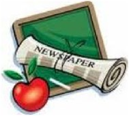 newspaper on slate with apple