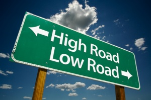 highway sign that points to high road in one direction and low road in the opposite direction