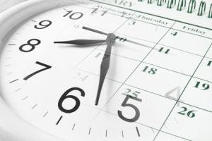Clock face overlaid on a calendar