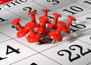 calendar with many red tacks on one day