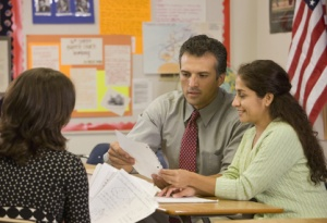 three teachers collaboratively analyzing student work samples